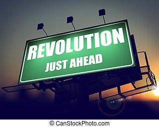 Revolution Just Ahead - Green Billboard on the Rising Sun Background.