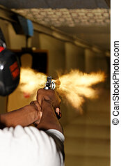Revolver Gun fired with Muzzle Flash - A picture taken over...