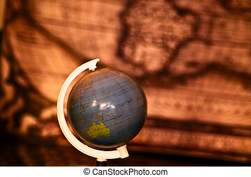A globe rotating and showing a map of Australia and Oceania.