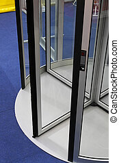 Automatic revolving glass door with electronic lock