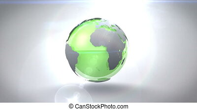 Revolving green earth on bright background