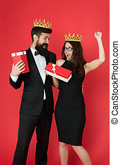 Reward celebration. Happy couple celebrate success. Sexy woman and bearded man wear crowns. Best employee celebration. Recognition and celebration. Holiday party. Enjoying celebration