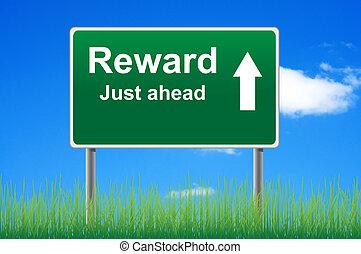 Reward road sign on sky background, grass underneath.