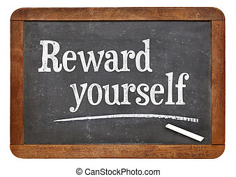 Reward yourself - motivational words on a vintage slate...