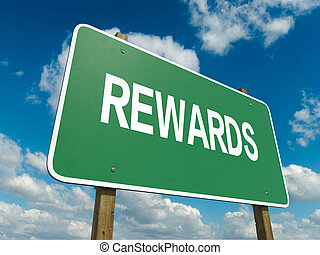 rewards - A road sign with rewards words on sky background