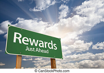 Rewards Green Road Sign Against Clouds and Sunburst.