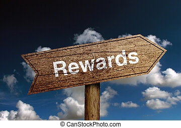 Rewards Text - Wooden road sign with text Rewards against...