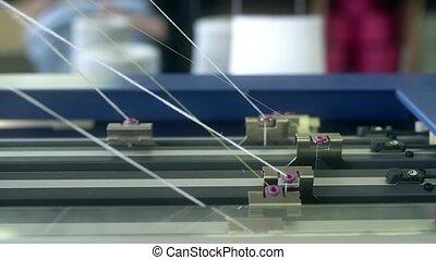 Rewinding machine at a knitting shop video