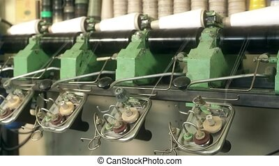 Rewinding machine at knitting shop close up video -...