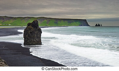 Reynisfjara Beach view point Dyrholaey. Famous Iceland black sand beach on South Iceland. Icelandic nature landscape tourist attraction destination. 4K.