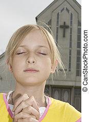 rezando, adolescente