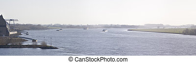 rhine river - cargo ships on the rhine at emmerich, germany