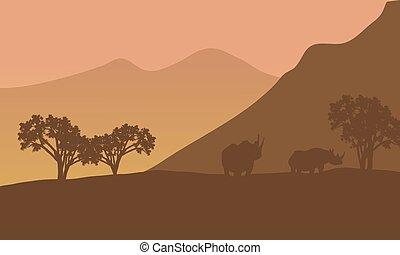 Rhino silhouette on the mountain