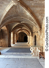 Columns and archs in the passage of archaeological museum in Rhodes, Grand master's palace, knights of rhodes. Greece