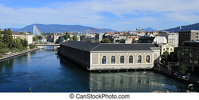 Rhone river, Batiment des Forces Motrices and fountain at Geneva, Switzerland