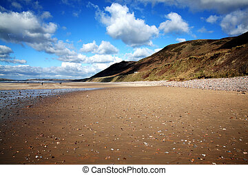 Rhossili Bay Gower Peninsular West Glamorgan Wales UK, a popular Welsh coastline landmark attraction for a visitor travel destination of outstanding beauty