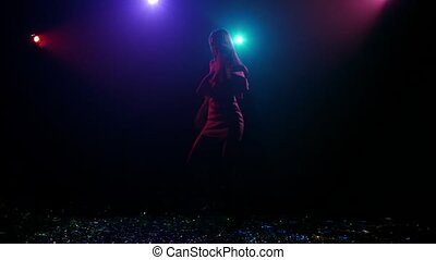 Rhythmic dance of silhouette girl with disco style lights