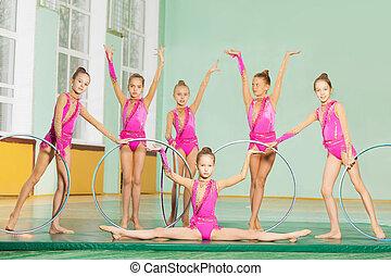 Rhythmic gymnastic team performing hoop routine