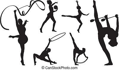 rhythmic gymnastics with apparatus - girls exercising with...
