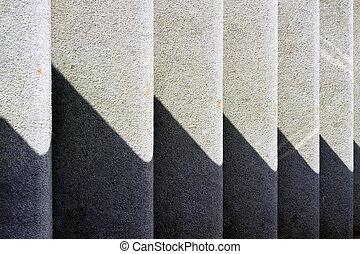 Rhythmic shadow on the steps of a sunny day