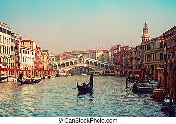 Rialto Bridge and gondolas  in Venice.