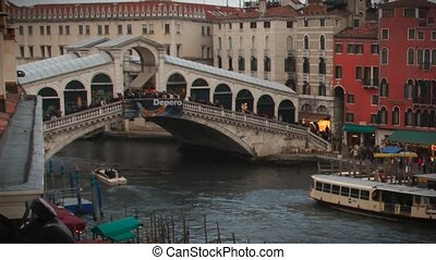 Rialto Bridge Timelapse during twilight with boat traffic