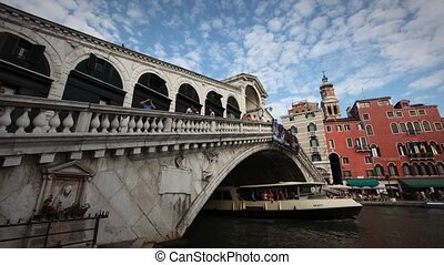 Rialto Bridge Timelapse with clouds in a blue sky