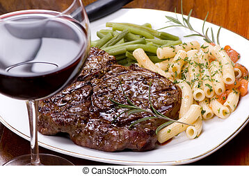 Rib Eye Steak Dinner 5 - A grilled rib eye steak with...