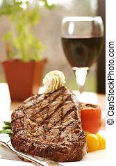 Rib Eye Steak - 12oz ribeye steak topped with truffle butter...