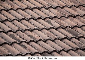 ribbed tiled roof old and weathered closeup background dark brown