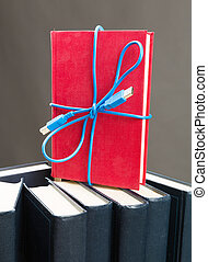 Ribbon from the usb cable on book
