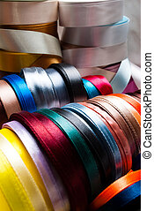 ribbons - many-coloured ribbon spools in the craft