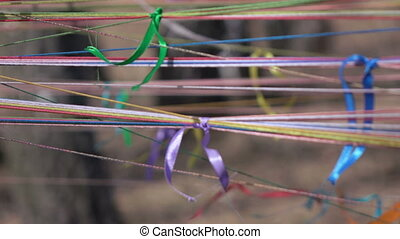 Ribbons on the threads - On the strands stretched between...