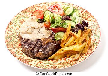 Ribeye steak dinner - Dinner plate of grilled rib-eye beef ...