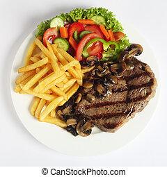 Ribeye steak dinner from above - A grilled ribeye steak...