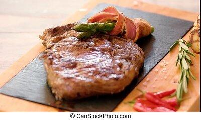 Ribeye steak on board.