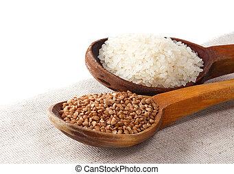 rice and buckwheat in spoon