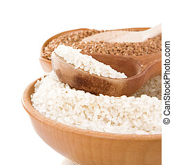 rice and buckwheat isolated on white
