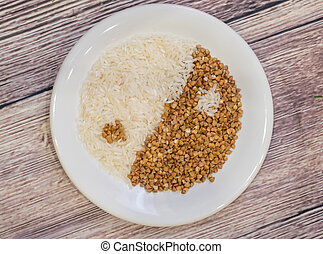 Rice and buckwheat one on a white plate