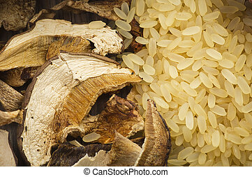 Rice and dried porcini mushrooms on table