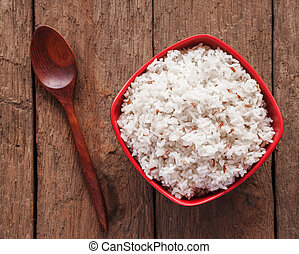 Rice berry, Brown rice in a bowl on brown wooden background, Still life tone