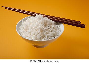 Rice, bowl and chopsticks