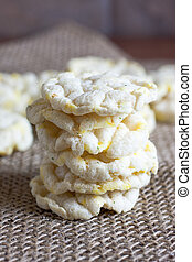 Rice Cakes - Puffed rice cakes on a wooden table.