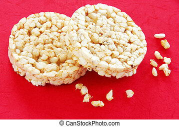 Rice cakes - two round rice cakes over red background