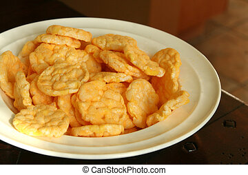 Rice crackers on white plate