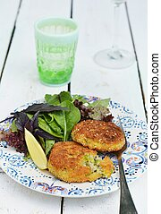 rice croquette with peas, herbs and green salad