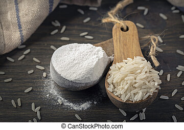 Rice flour in a wooden spoon