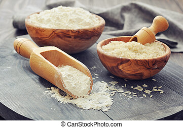 Rice flour - Raw rice and flour in bowls with scoop on ...