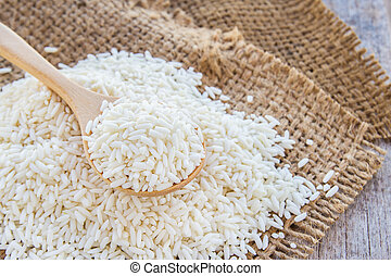 rice grains in a wooden spoon