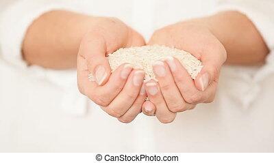 Rice in Her Hands
